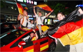 Supporters of the German national soccer team celebrate Germany and Algeria in Brazil