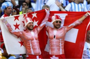 Swiss fans cheer for their team before the FIFA World Cup 2014