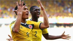Teofilo Gutierrez of Colombia, on the left, celebrates scoring his team's second goal with Cristian Zapata during the 2014 FIFA World Cup Brazil