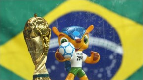 The 2014 FIFA World Cup official Mascot Fuleco and replica of the World Cup