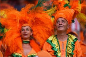 The Netherlands fans look on wearing feathered headdresses during the 2014 FIFA World Cup Brazil