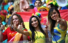 Three Brazil fans show their enthusiasm for their national team before kick off