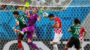 Vedran Corluka of Croatia clears the ball off the line during the 2014 FIFA World Cup Brazil Group A match between Croatia and Mexico