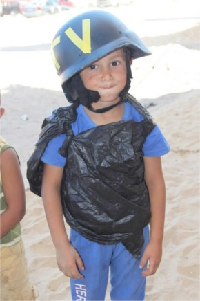 Young Boy In Gaza Pretending To Be A Journalist With His Homemade Flak Jacket, Had To Lend Him My Helmet