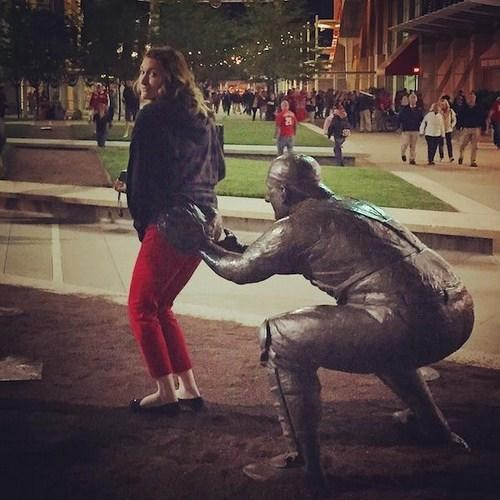girl in awkward and funny pose with statue -2 Scarlett Johansson