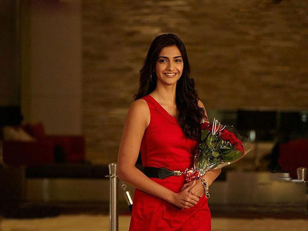 Sonam kapoor in red dress with red flowers with natural ...